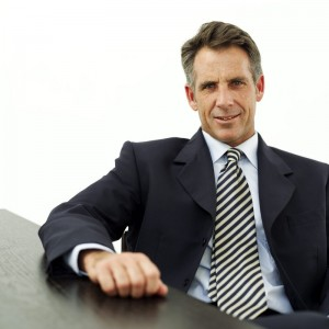 Mature Businessman Seated at a Table